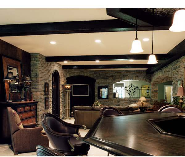 The finished lower level includes a media room rec room exercise room billiards area bar and guest bedroom.
