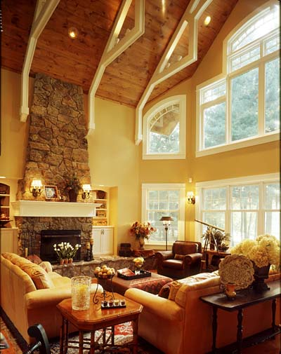 The great room's impressive wall of windows brings the outdoors inside.