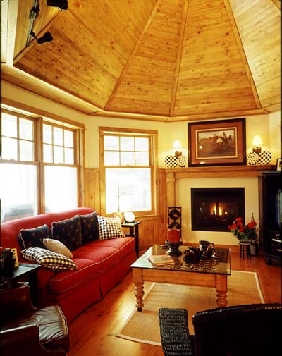 The octagon-shaped hearth room with its vaulted ceiling invites friends and family to curl up by the fire.