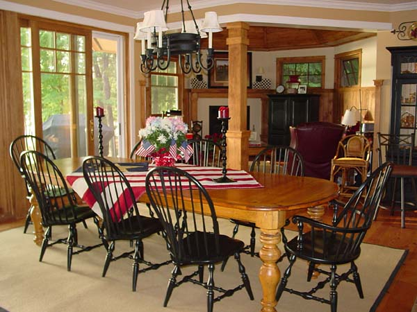 The dining room with great views to the outside is open to both the hearth room and great room.