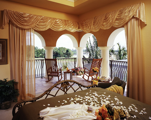 Luxurious views onto the covered balcony from the upper level guest suite.