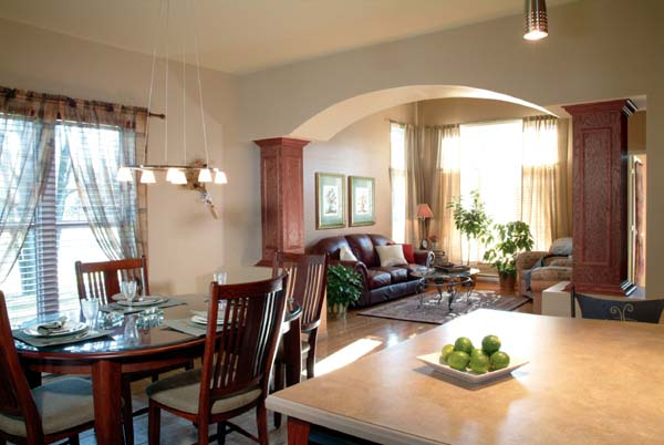 Natural light brightens the view from the kitchen to the dining area and living room.