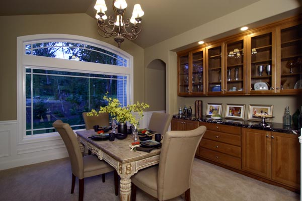 The dining room is served by built-in cabinetry and convenient access from the kitchen.