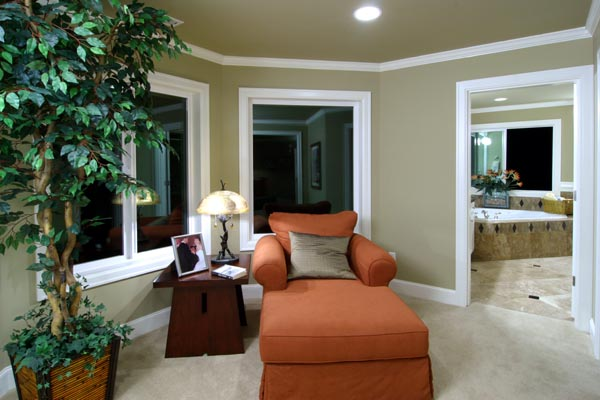 The master suite's sitting area accesses the bath presenting a choice of venues in which to curl up with a book.
