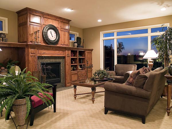 The great room with its handsome built-in display cabinets and fireplace offers generous views to the outside.