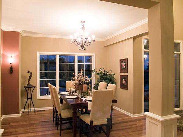 The comfortably sophisticated dining room resides in open view of the foyer.